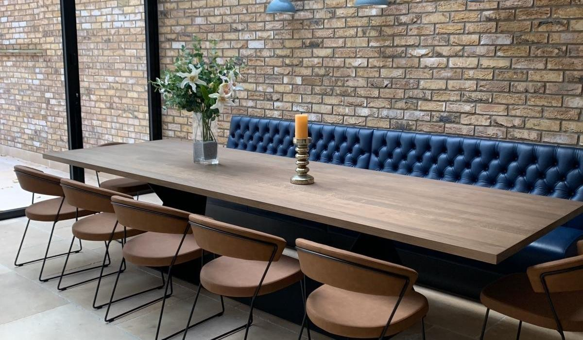 Residential dining table blue leather button back banquette | Craftwood INneriors