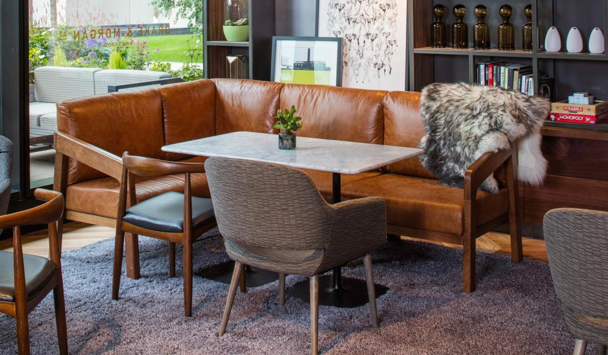 Settee-style seating with bespoke wooden frames